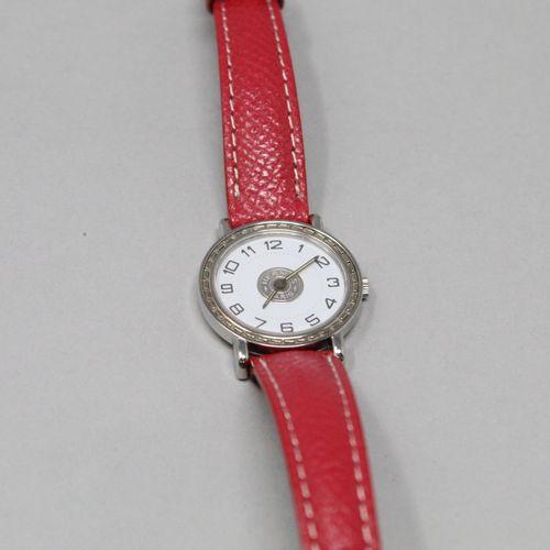 HERMES  Montre bracelet de dame, boîtier rond, cadran à fond blanc à chiffres ar…