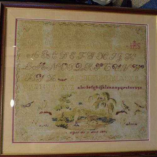Marie Gatoux在1876年11岁时绣的字母表。  53x60厘米 穿着。装裱:71x78厘米。