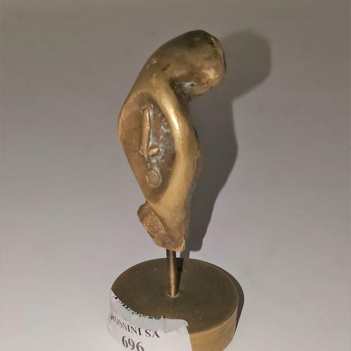 BELO Andre (né en 1908)  Visage  Bronze. Au dos BELO  Ht. : 8.5 cm