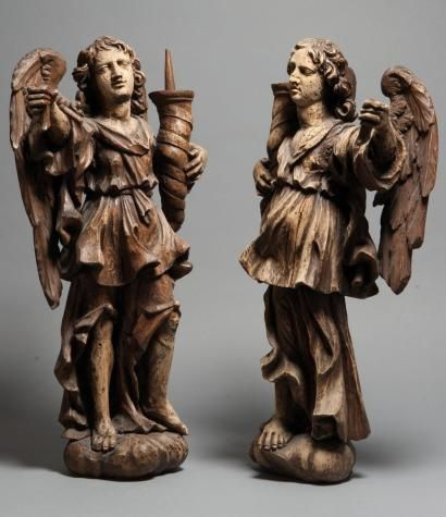 Pair of carved and patinated wood cerophorean angels, each carrying a twisted ho…