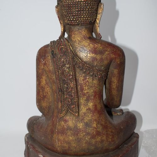 THAILAND 20th century.  Lacquered and gilded wood Buddha.  H. 50cm.  Wear and te…