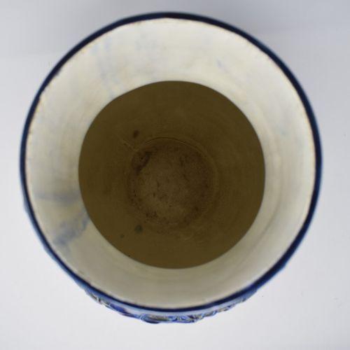 CHOISY LE ROI  Vase en faïence bleue à décor en relief d'animaux  H.: 41 cm D. D…