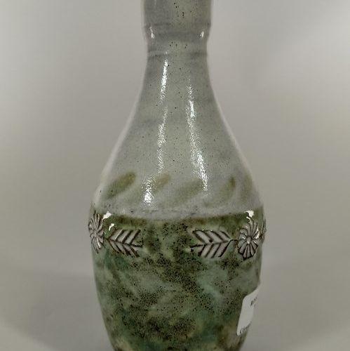 DERVAL Jean (1925 2010)  Vase à décor de fleurs.  Terre de Vallauris, signature …