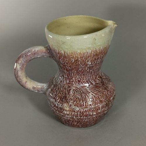ACCOLAY (1948 1980)  Lot de cinq pièces dont un vase noir, vers 1950.  Terre cha…