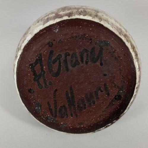 GRANET (XXe siècle)  Lot de deux pièces :   Vase Pique fleurs.  Terre de Vallaur…