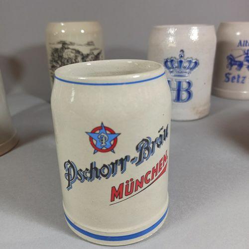 Travail allemand du XXème siècle,  Lot de 7 chopes à bière publicitaires en céra…