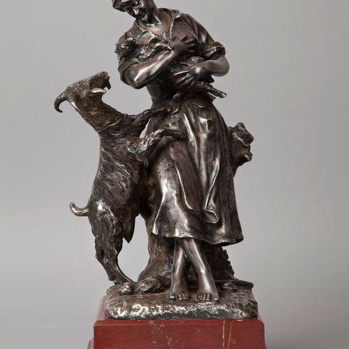 DAME Ernest, 1845 1920  La gardienne de chèvres  bronze argenté, signé sur la te…