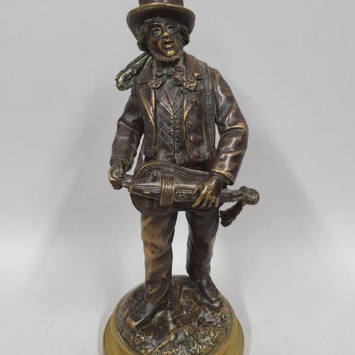 CHAUVIN (XIXème)  Le joueur de vielle  Bronze à patine brune nuancée, sur l'arri…