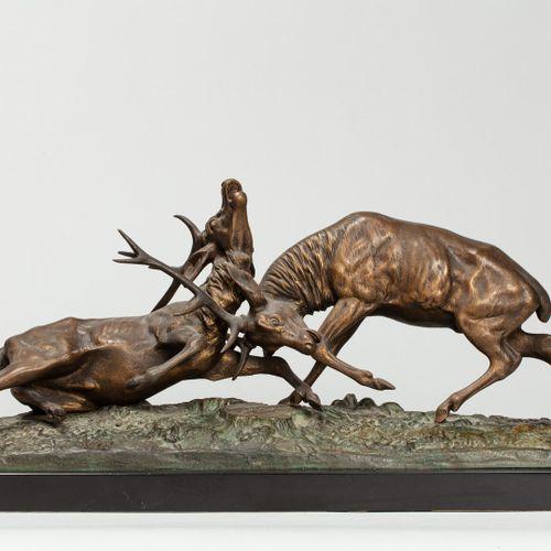 DU PASSAGE Edouard Guy (1872 1925)  Combat de cerfs,  groupe en bronze à patine …