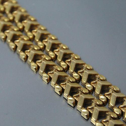Bracelet or jaune 18k (750) à maille ajourée.  Tour de poignet : 19 cm. Poids : …
