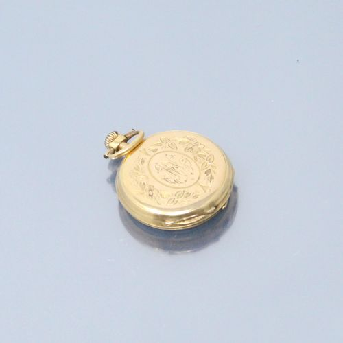 Montre de col en or jaune 18k (750) et son porte montre en verre , cadran à fond…