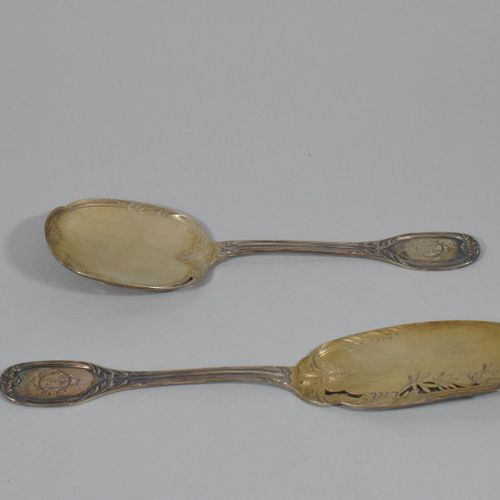 COIGNET Louis (1893 1928)  Silver fish cutlery with a rich foliage decoration, t…