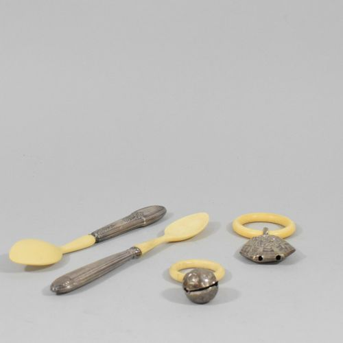 Two porridge spoons with a silver handle and two silver and ivory rattles.  Gros…
