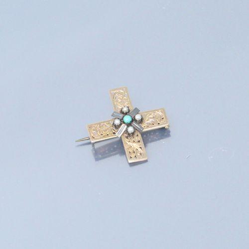 Epingle en forme de croix en or jaune 18k (750) sertie en son centre de quatre p…