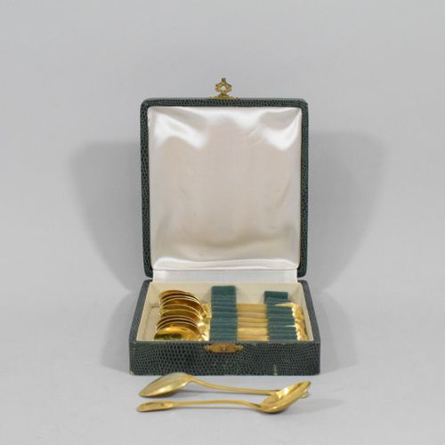 Twelve gilt metal mocha spoons.  In their case.