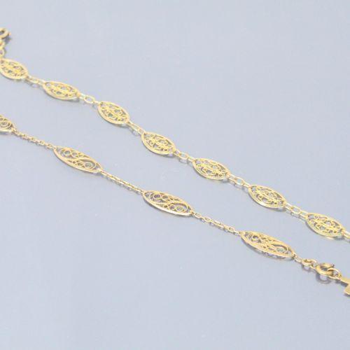 Lot de deux bracelet en or jaune 18k (750) à maille forçat alterné de maille nav…
