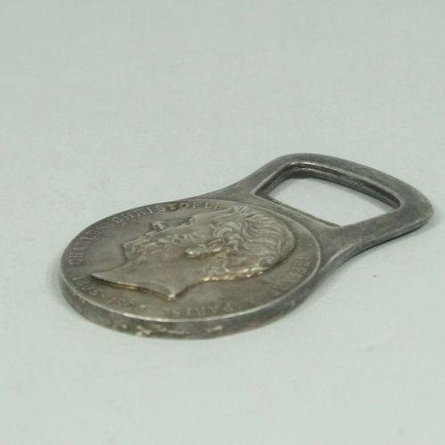 CHRISTOFLE  Décapsuleur en métal argenté. Avers : Charles Christofle de profil g…