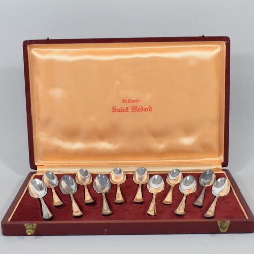 Twelve small spoons in silver plated metal, poly lobed model.  In a case inscrib…