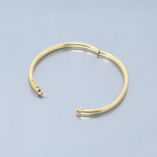 Bracelet jonc en or jaune 18k (750)  Poinçon de maître.  Poinçon tête d'aigle.  …