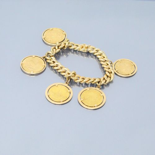 Gourmette en or jaune 18k (750) ornée de pièces en or comprenant :   10 Mark Vil…