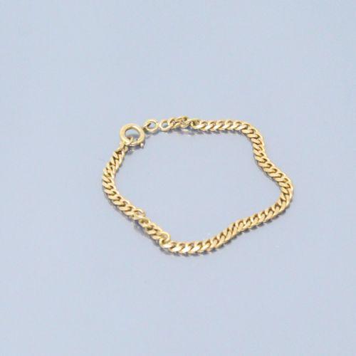 Bracelet d'enfant en or jaune 18k (750) maille gourmette.  Poinçon tête d'aigle.…