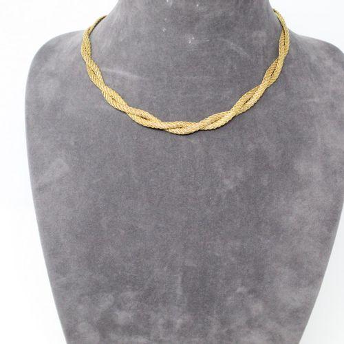 Demi parure en or jaune 18k (750) à maille tressée comprenant un collier et un b…