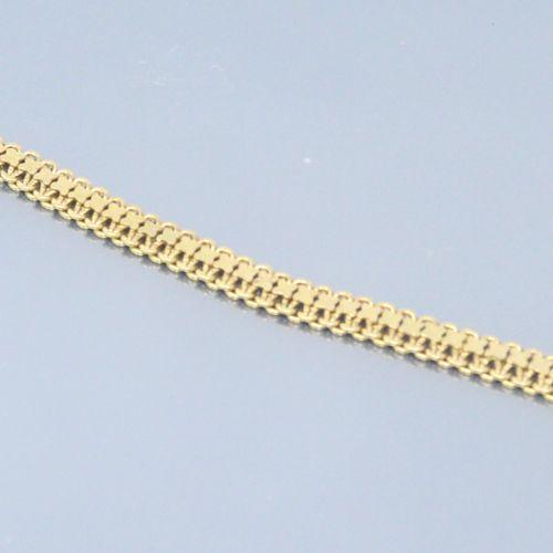 Bracelet en or jaune 18k (750) à maille fantaisie.  Poinçon tête d'aigle.  Tour …