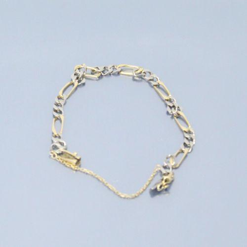 Bracelet en or gris et jaune 18k (750) à maille figaro. Chainette et cliquet de …