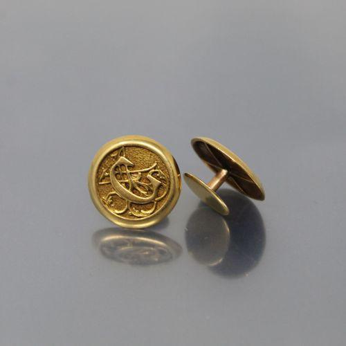 Paire de boutons de manchette en or jaune 18k (750) de forme circulaire chiffrés…