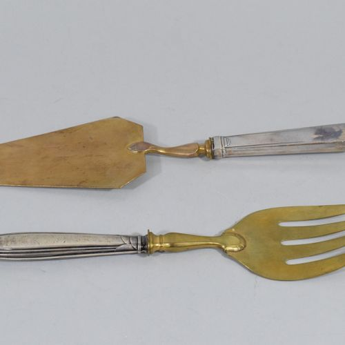 Two serving pieces (not matching), the spatulas in metal, the handles in filled …