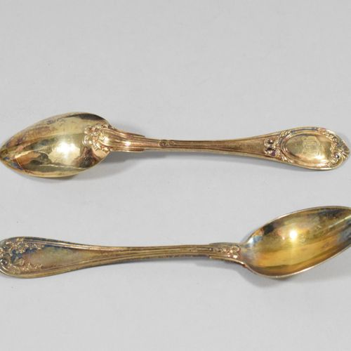 Twelve small vermeil spoons in the Louis XVI style, the spatula figured.  Goldsm…