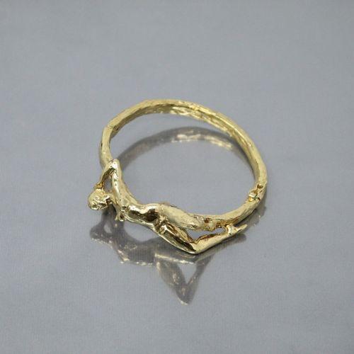 Michel AUDIARD  Bracelet articulé en bronze à cire perdue doré orné d'une femme …