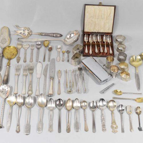 Lot of mismatched flatware including forks, spoons, serving pieces mainly in sil…