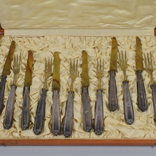 Filled silver (Minerve) dessert cutlery, six forks and six knives, the handle de…