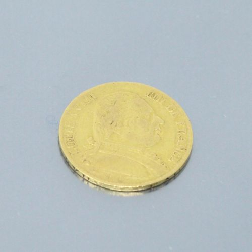 Pièce en or de 20 Francs Louis XVIII buste habillé (1815 W).  TB à TTB, l'un des…