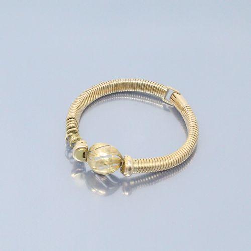 Débris de bracelet en or jaune 18k (750).  Poids : 22.15 g.