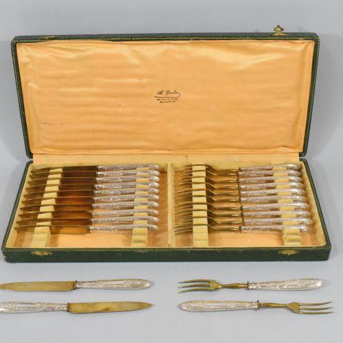 Silver and gilded metal dessert service including twelve forks and twelve knives…