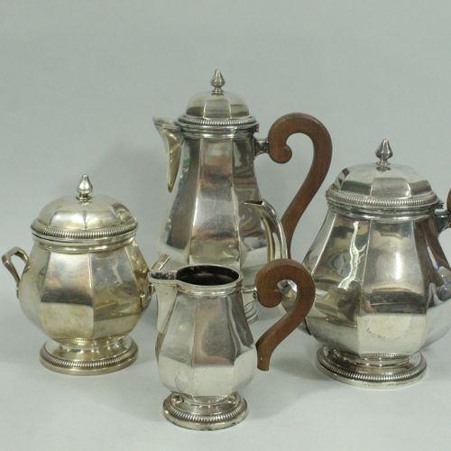 GRUHIER  Service à thé/café en métal argenté, la panse à pans coupés, la base et…