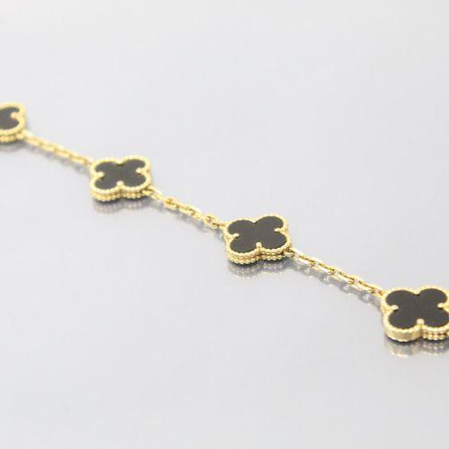 VAN CLEEF & ARPELS  Demi parure Alhambra en or jaune 18K (750) et onyx composée …