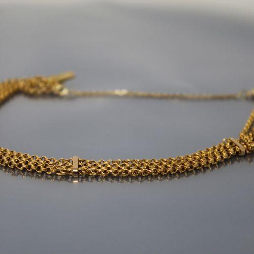 Bracelet en or jaune 18k (750) à quatre rangs maille forçat.  Tour de poignet : …