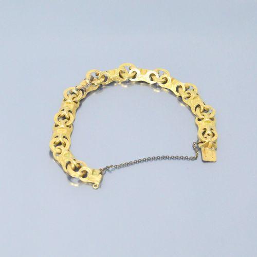 Bracelet en or jaune cisellé 18k (750). Chaînette de sécurité en métal.  Poids b…