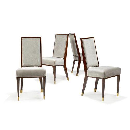 ~ JEAN ROYÈRE (1902 1981) Suite de huit chaises en hêtre teinté reverni, piéteme…