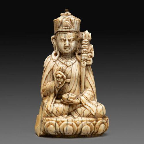 ~STATUTE OF PADMASAMBHAVAin carved ivory patina, represented sitting in vajrasan…