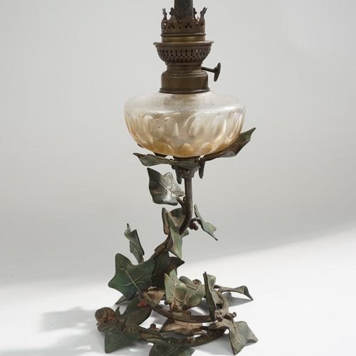 Kerosene lamp decorated with scrolls of ivy leaves and snails. Polychrome bonze …