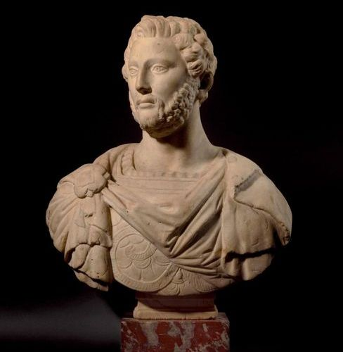 White marble bust probably representing a Roman emperor, resting on a base inscr…