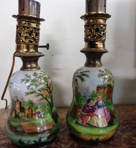 Pair of oil lamps in the form of a baluster in painted porcelain with a gallant …