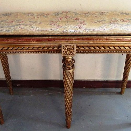 Pretty piano bench in carved and gilded wood in the Louis XVI style, it rests on…