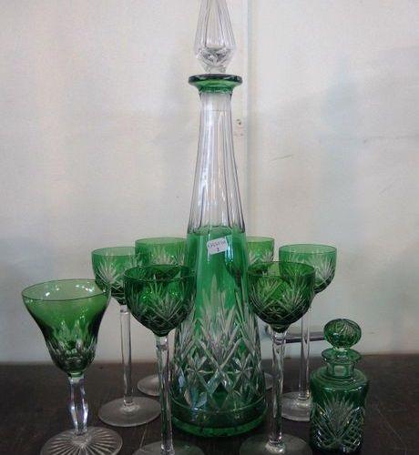 A small green lined cut crystal liqueur set  A carafe, six glasses, a small stem…