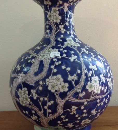 A vase with tight neck in porcelain of China, decorated with cherry branches.  H…