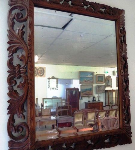A large 20th century mirror with a carved wood frame in the Henri II style.  112…